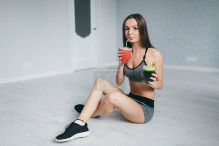 Fitness girl drink cocktails