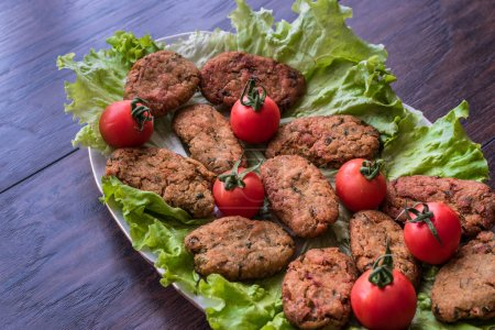 Chickpeas Falafel with parsley and cherry tomatoes.