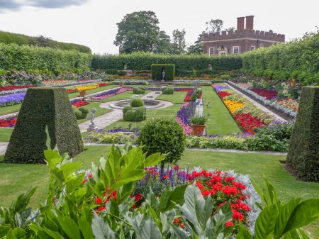Photo for Arden at Hampton Court Palace near London, UK with flowers in bloom - Royalty Free Image