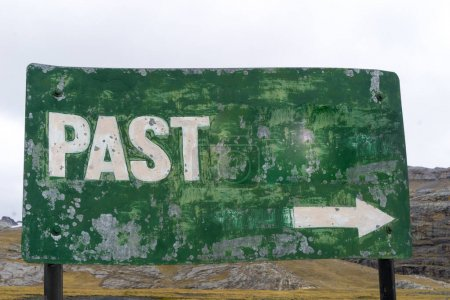 green metal sign with the word past and a white arrow showing the way back in time