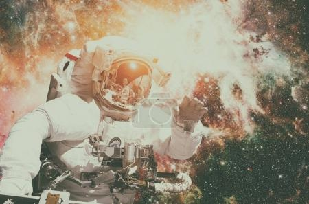 Astronaut in outer space against the backdrop of the outer space