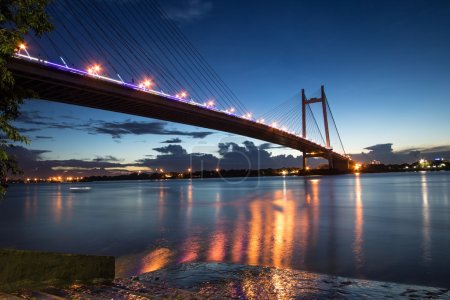 Vidyasagar bridge (setu) on river Hooghly at twilight time. This is the longest cable stayed bridge in India. The bridge connects Kolkata with the Howrah district of West Bengal.