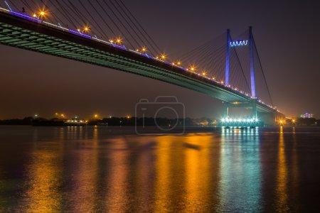 Vidyasagar Setu ( bridge ) on river Hooghly under night illumination.