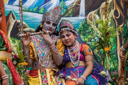 Kids pose as Lord Krishna and Radha on the occasion of Iskcon Rath Yatra ceremony at Kolkata, India.