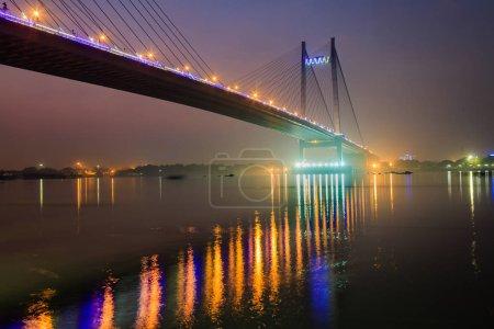 Vidyasagar Setu (bridge) on river Hooghly at dusk with night illumination.