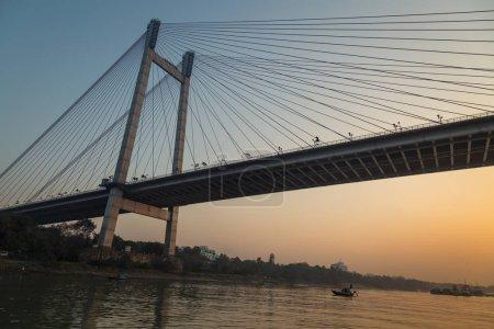 Vidyasagar setu (bridge) as seen from a boat on river Hooghly at twilight. Kolkata, India.