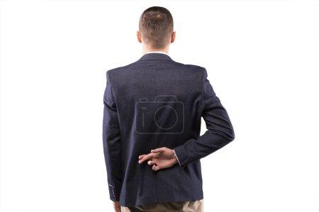 Businessman fingers crossed behind his back...