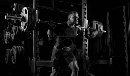 The weightlifter is preparing to lift a very heavy barbell.