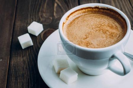 Fresh cup of coffee and sugar
