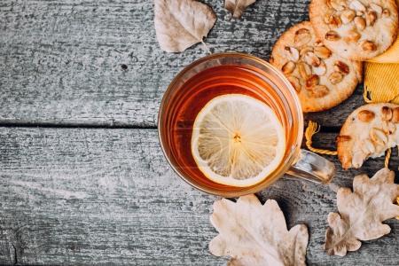 Hot cup of lemon tea with cookies