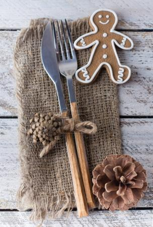 Cutlery with gingerbread on table
