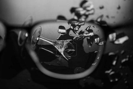Elegant broken wine glass through glasses