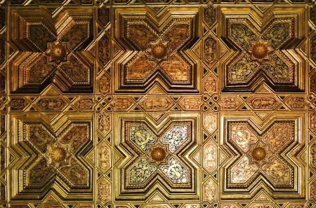 TOLEDO, SPAIN - FEBRUARY 8, 2017: A ceiling of the Primate Cathedral of Saint Mary of Toledo, decorated with mudejar style elements and geometry figures, Castilla-La Mancha, Spain.