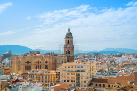 Aerial panoramic view over the roofs to a tower of Malaga Cathed