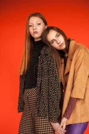 Fashion portrait of two young caucasian girls in stylish clothin