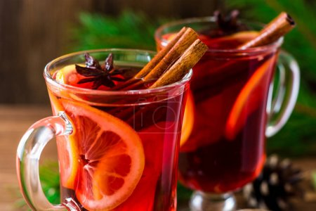 Christmas mulled wine on wooden background.