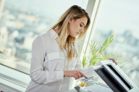 young businesswoman scans documents in the office