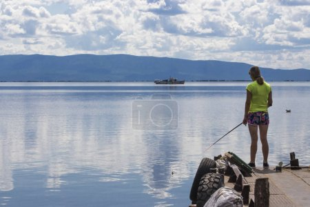 The girl is fishing for