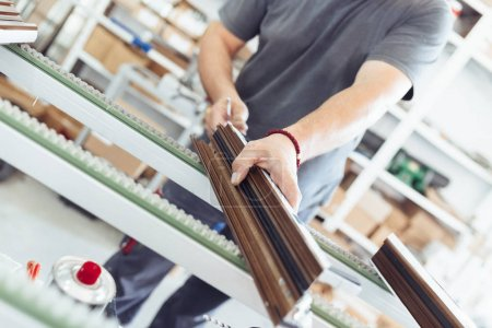 Manual worker assembling PVC doors and windows