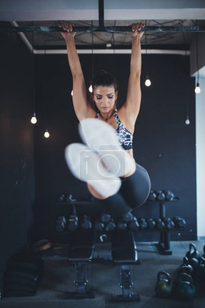 Beautiful athletic woman - fitness workout in gym