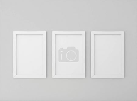 room with empty picture frames on wall