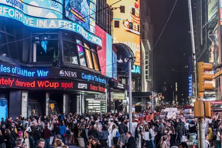 Photo for New York City - United States - 25.05.2014 - Times Square by night people walking around - Royalty Free Image