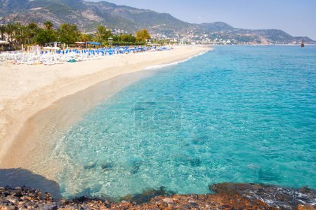Tropical resort sea beach on summer vacation. Beach with white sand, Alanya Turkey.