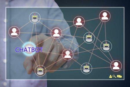 Photo pour Chatbot concept. Homme de pointage chatbot lien réseau et texte à l'écran. - image libre de droit