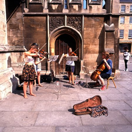 oung street musicians playing by the Abbey, Bath.