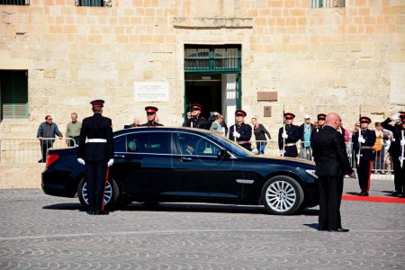 Political dignitaries arriving outside the Auberge de Castille in Castille Square in a limousine for the EPP European Peoples party congress with military personnel in attendance, Valletta