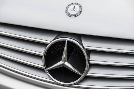 Milan, Italy - February 19, 2017 - Mercedes Benza car logo on a silver Mecedes Benz car.