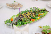 Big fish on table during catering event. Catering buffet.