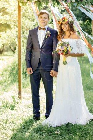 Beautiful wedding couple - bride and groom during wedding ceremony.