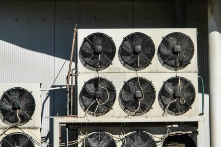Photo for Air conditioning and refrigeretion system outside unit - compressors and condensers - Royalty Free Image