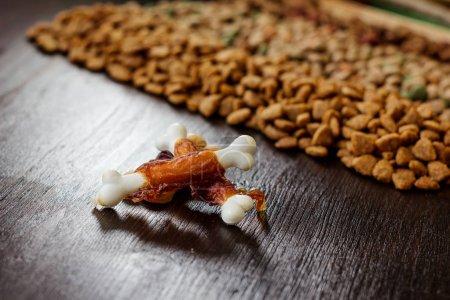 Calcium bones for dog feeding on wooden background