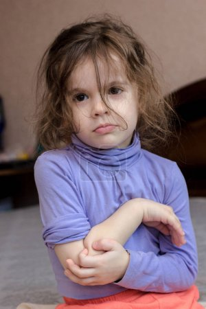 Little kid girl with pain in elbow