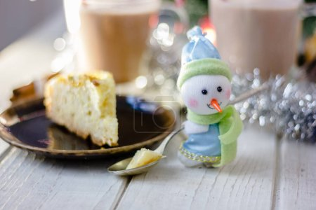 Photo for Christmas snowman holding spoon with christmas pie in hands - Royalty Free Image