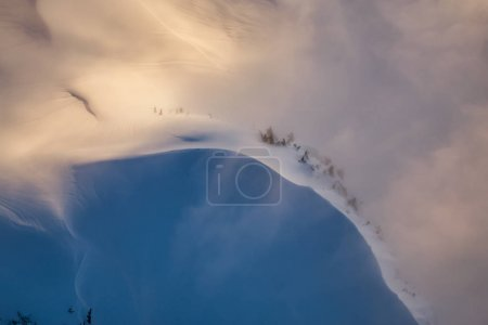 Snow covered mountain ridge