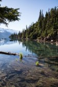 panoramic landscape view of the beautiful rocky islands in glacier lake with mountains in the background
