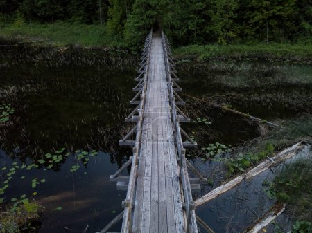 Aerial view of a wooden bridge in Brohm Lake during sunset. Taken between Whistler and Squamish, North of Vancouver, British Columbia, Canada.