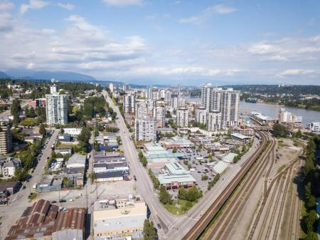New Westminster, Greater Vancouver, BC, Canada - June 11, 2017 - Aerial view of the city, shopping mall and railroad tracks.
