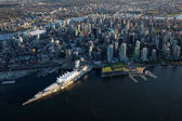 Beautiful Aerial View of Vancouver Downtown, British Columbia, Canada, during a bright spring sunset.