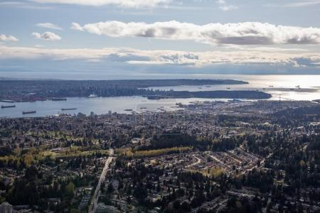 Aerial view of North Vancouver with Stanley Park and Downtown in the Background. Taken in Britiish Columbia, Canada.