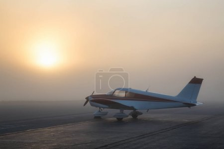 Pitt Meadows, Greater Vancouver, British Columbia, Canada - May 02, 2017 - Airplane parked at the Airport during a foggy sunrise.
