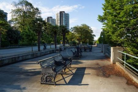 Photo for Benches at English Bay Beach Park, Dowtown Vancouver, British Columbia, Canada. Taken during a sunny morning. - Royalty Free Image