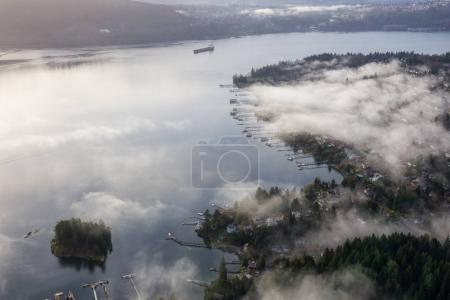 Beautiful view on the luxury homes in Deep Cove, Greater Vancouver, British Columbia, Canada. Taken during a cloudy early morning from an aerial perspective.