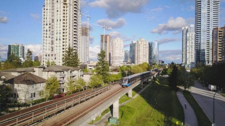 Aerial view of Skytrain in front of Metrotown, Vancouver City, BC, Canada.