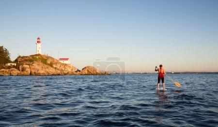 Paddle Boarding by Lighthouse