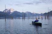 Girl Kayaking in a Lake