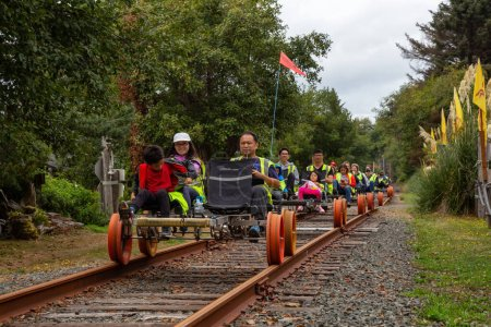 Photo for Rockaway Beach, Oregon, United States of America - September 7, 2019: Group of people Railbiking on the rail road tracks. - Royalty Free Image